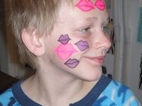 Face Paint Boy with Kisses painted on his Face